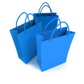 Trio of blue shopping bags — Stock Photo