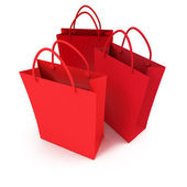 Trio of red shopping bags — Stock Photo