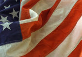 Close-up shot of and old American Flag — Stock Photo