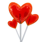 Heart shaped red lollipops — Stock Photo