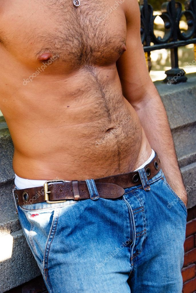 Hairy torso of a young man leaning on a wall  Stock Photo #2215335