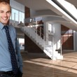 Smiling man in an expensive loft — Stock Photo