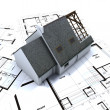 Detached house on architect blueprints — Stock Photo