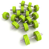 Group of green dumbbells — Stock Photo