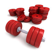 Red dumbbells and heap of weights — Stock Photo
