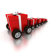 Row of red gift boxes with wheels — Stock Photo