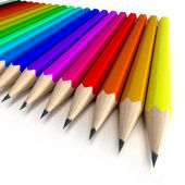 Colorful pencils neatly arranged — Stock Photo