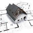 House on blueprints with red corrections — Stock Photo