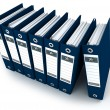 Blue ring binders in a row - Stock Photo