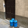 Stock Photo: Butane gas cylinders at house door