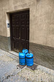 Butane gas cylinders at a house door — Stock Photo