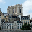 Notre Dame de Paris seen from the Seine - Stock Photo