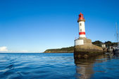 Lighthouse and breakwater — Stock Photo