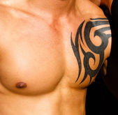 Male torso with tattoo — Stock Photo