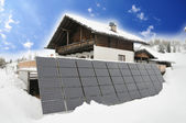 Mountain cottage with solar panels — Stock Photo
