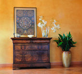 Vintage dresser and print with plant pot — Stock Photo