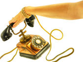 Female hand answering old style phone — Stock Photo