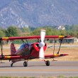 Red biplane taxying — Stock Photo