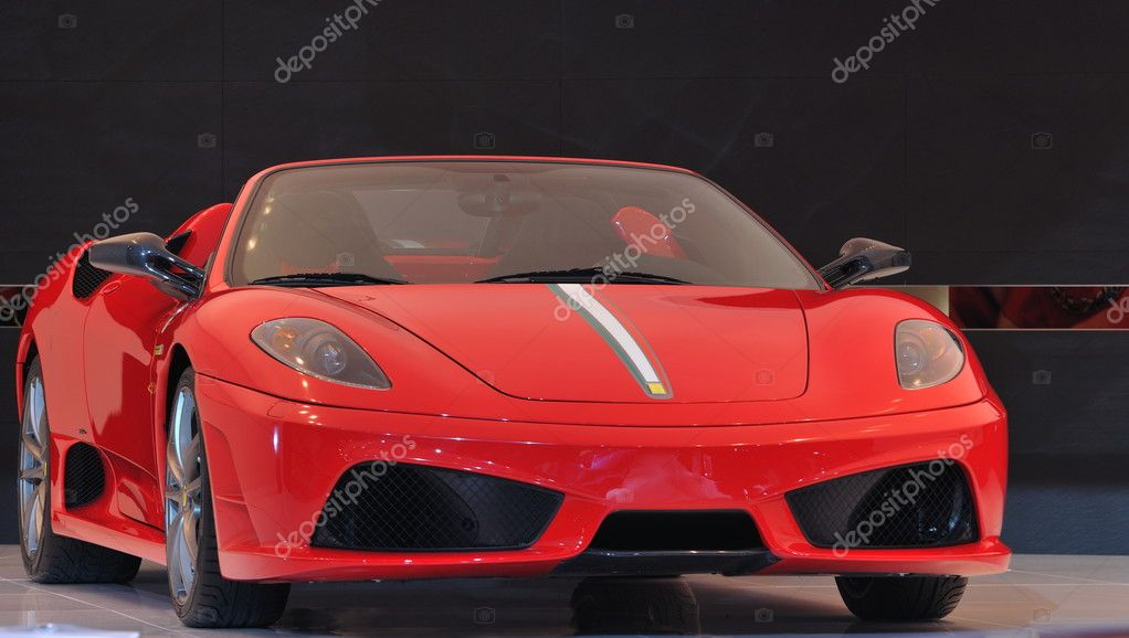 Modern red italian supercar, two seater spider with italian flag strip on the hood — Stock Photo #2393509