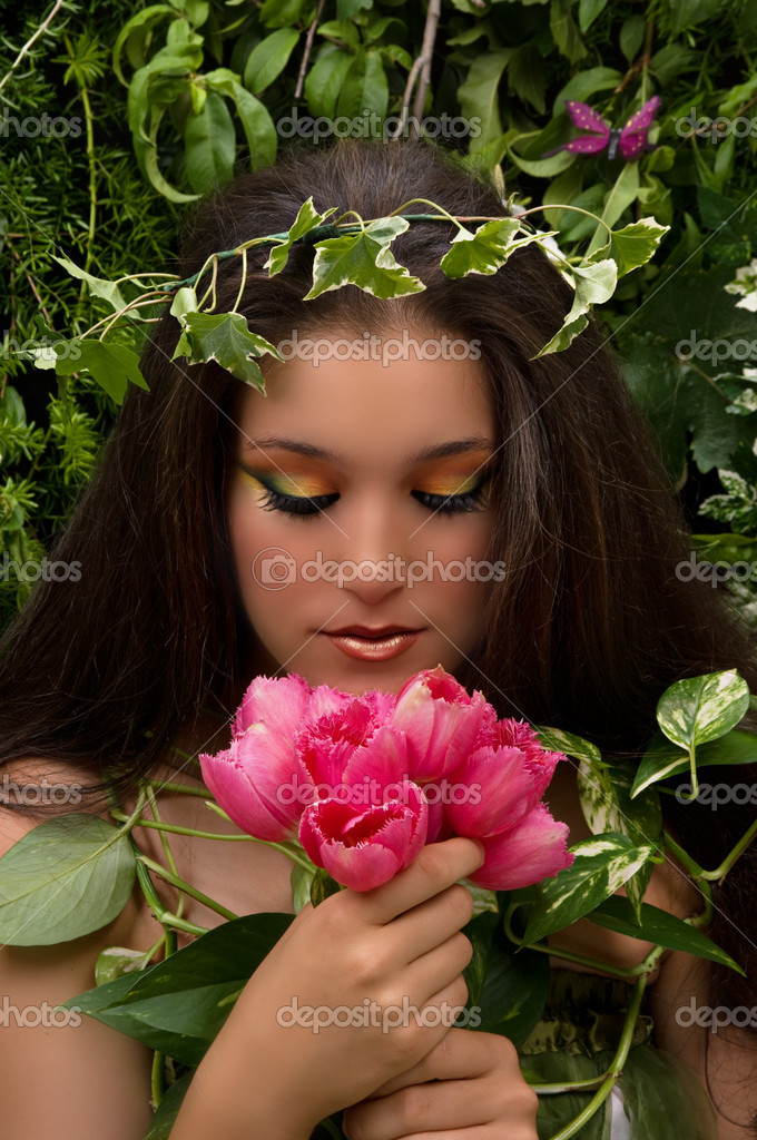 Nature fairy with beautiful make up and tulips — Stock Photo #2218342
