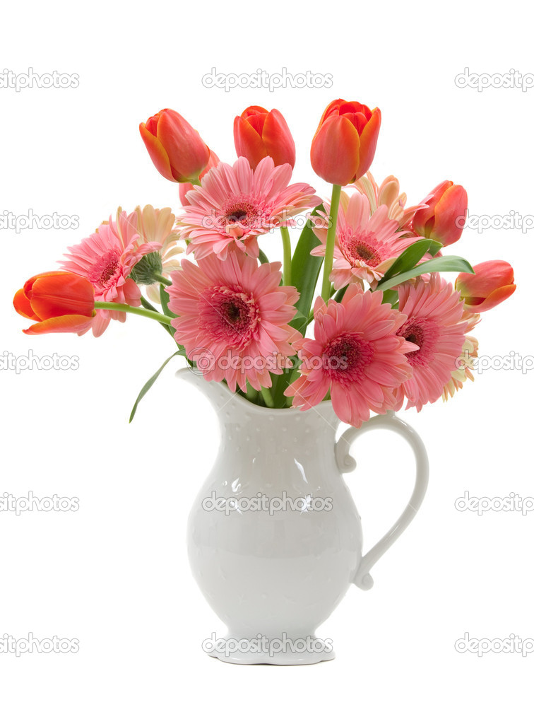 A bouquet of daisy gerberas and tulips in a beautiful pitcher vase — Stok fotoğraf #2225174