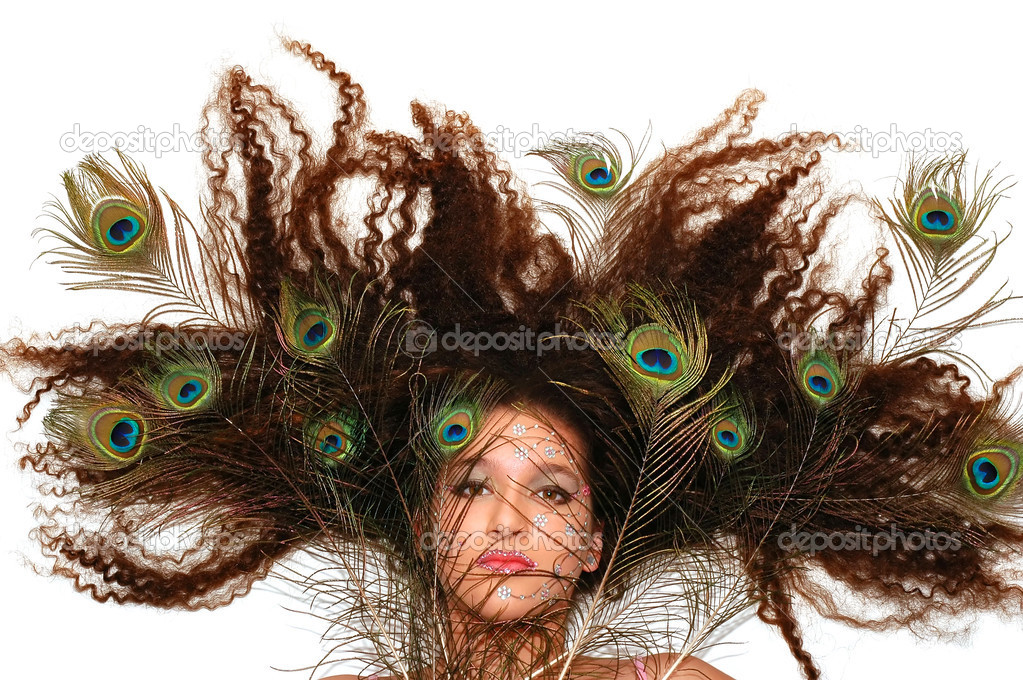 Girl wearing makeup made of rhinestone flowers with peacock feathers in her hair          — Stock Photo #2225578