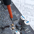 Repair a computer surface-mounted board — Stock Photo