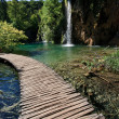 Stock Photo: Footbridge and waterfall- plitvice lakes