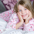 Cute Blonde Child Lying on her Bed — Stock Photo