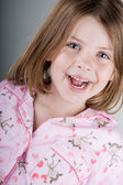 Happy Child in her Pyjamas — Stock Photo