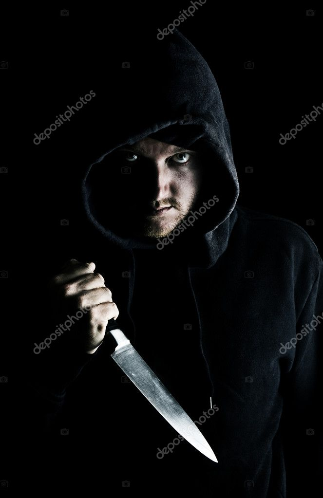 Intimidating Hooded Youth Clutching Knife to Chest  Stock Photo #2337373