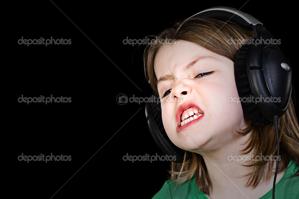 Young Child Singing with Headphones — Stock Photo #2338480
