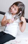 Schoolgirl Curling her Hair — Stock Photo