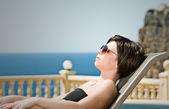 Brunette lady sunbathing — Stock Photo