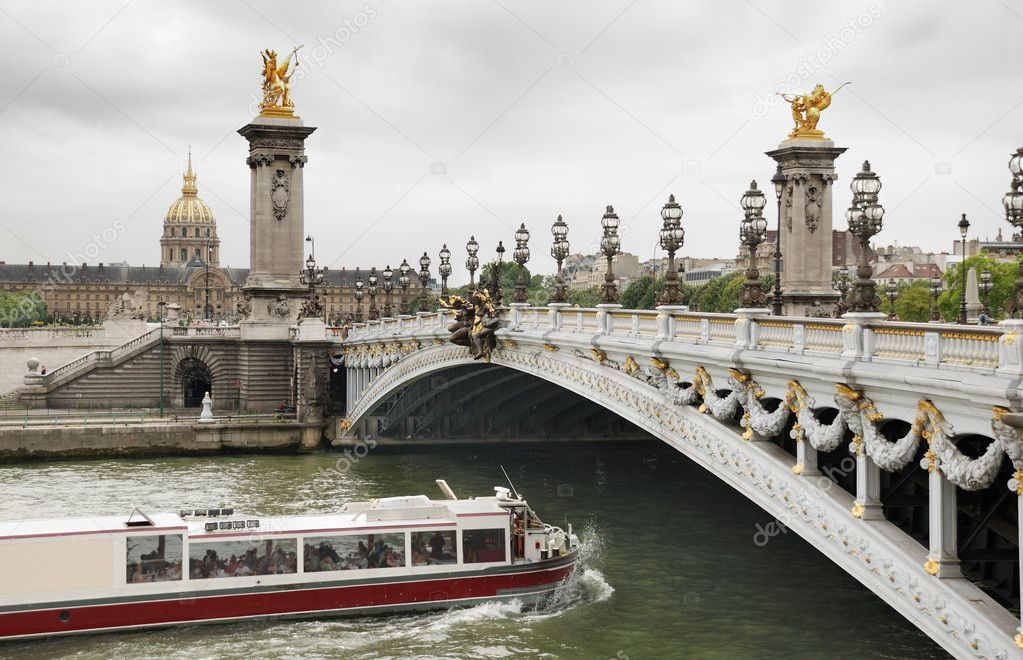 The Alexander III Bridge across Seine river and Les Invalides in Paris, France.  Stock Photo #2298463