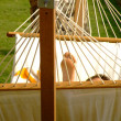 Relaxing vacation on hammock — Stock Photo #2223524