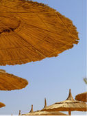 Straw parasols — Stock Photo