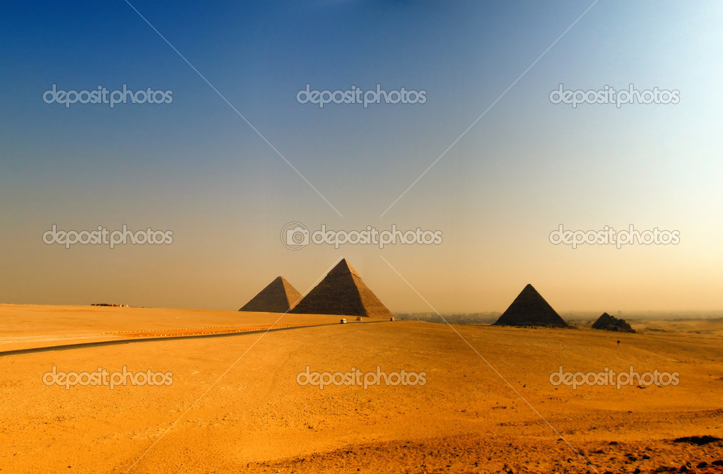 The great pyramids of giza in Egypt with cairo in the background  Stock Photo #2223397