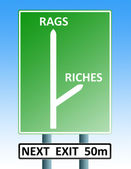 Rags riches roadsign — Stockfoto