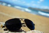 Cool shades on beach — Stock Photo