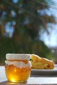 Honey jar with pastry — Stock Photo