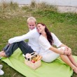 Back to back on romantic picnic — Stock Photo