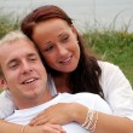 Girl embraces boyfriend — Stock Photo