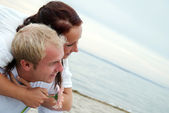Embracing partners on beach — Stock Photo