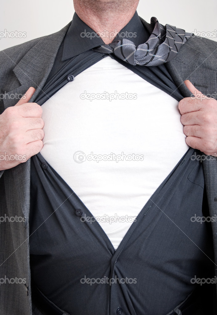 A business man tears open his shirt in a super hero fashion getting ready to save the day.  Stock Photo #2491864