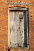 Door in side of barn — Stock Photo