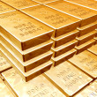 Stacks of gold bars - Foto Stock