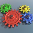 Brightly colored interlocking cogs — Foto Stock #2219869