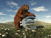 A bear bearing down on a Euro sign — Stock Photo