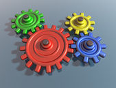 Brightly colored interlocking cogs — Foto Stock